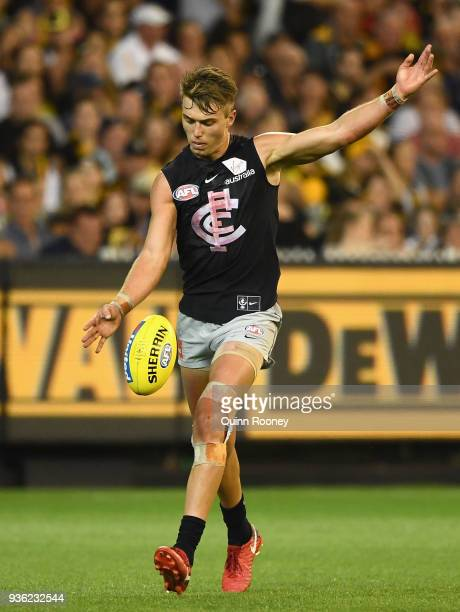 Patrick Cripps of the Blues kicks during the round one AFL match between the Richmond Tigers and the Carlton Blues at Melbourne Cricket Ground on...