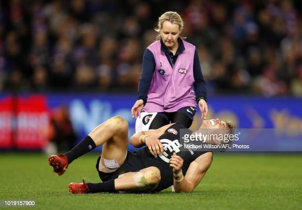 Patrick Cripps of the Blues lays injured during the 2018 AFL round 22 match between the Carlton Blues and the Western Bulldogs at Etihad Stadium on...