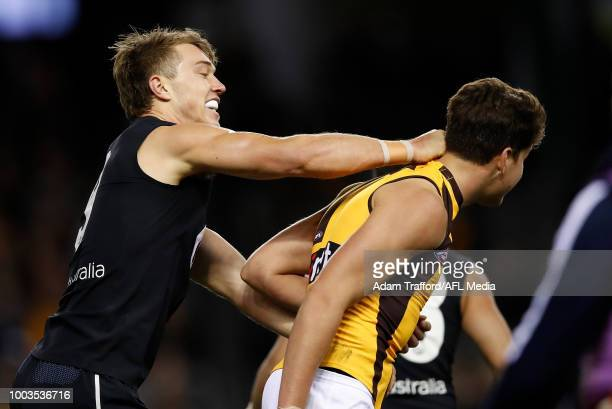 Patrick Cripps of the Blues remonstrates with Daniel Howe of the Hawks after Howe struck Cripps before a ball up during the 2018 AFL round 18 match...
