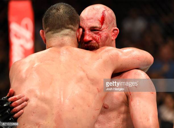 Patrick Cummins and Gian Villante embrace after finishing three rounds in their light heavyweight bout during the UFC Fight Night event inside the...