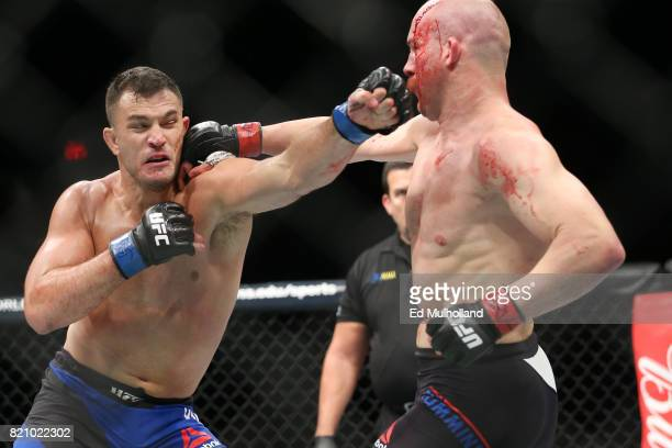 Patrick Cummins and Gian Villante trade punches during their UFC Fight Night light heavyweight bout at the Nassau Veterans Memorial Coliseum on July...