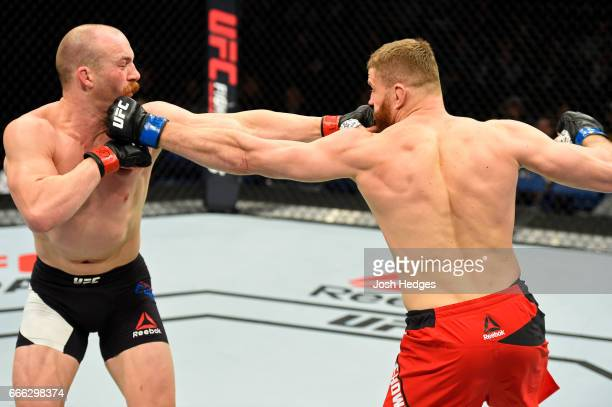 Patrick Cummins exchanges punches with Jan Blachowicz of Poland in their light heavyweight bout during the UFC 210 event at KeyBank Center on April 8...