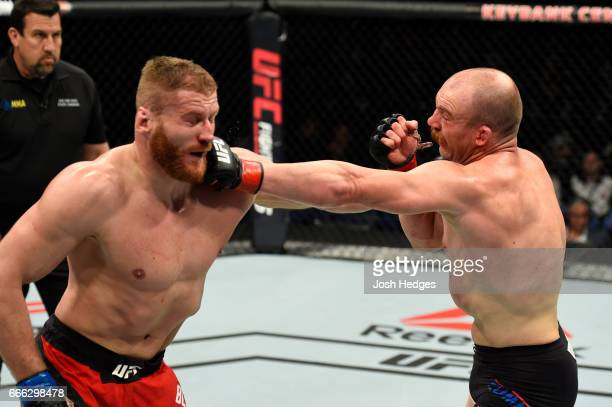 Patrick Cummins lands a punch on Jan Blachowicz of Poland in their light heavyweight bout during the UFC 210 event at KeyBank Center on April 8 2017...
