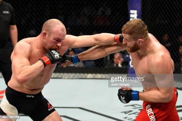 Patrick Cummins mixes it up with Jan Blachowicz of Poland in their light heavyweight bout during the UFC 210 event at KeyBank Center on April 8 2017...