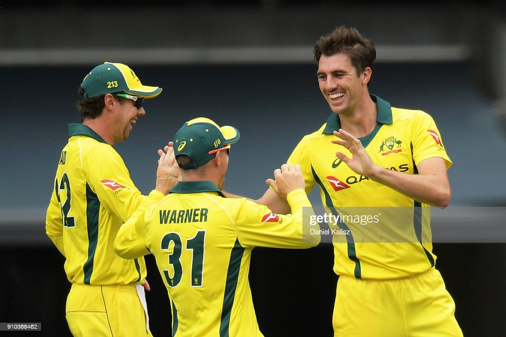 Patrick Cummins of Australia celebrates with his team mates after taking a wicket during game four of the One Day International series between Australia and England at Adelaide Oval on January 26, 2018 in Adelaide, Australia.