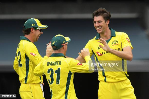 Patrick Cummins of Australia celebrates with his team mates after taking a wicket during game four of the One Day International series between...