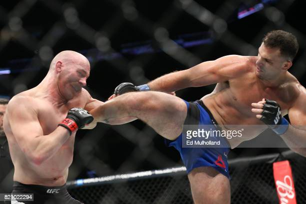 Patrick Cummins takes a kick from Gian Villante during their UFC Fight Night light heavyweight bout at the Nassau Veterans Memorial Coliseum on July...