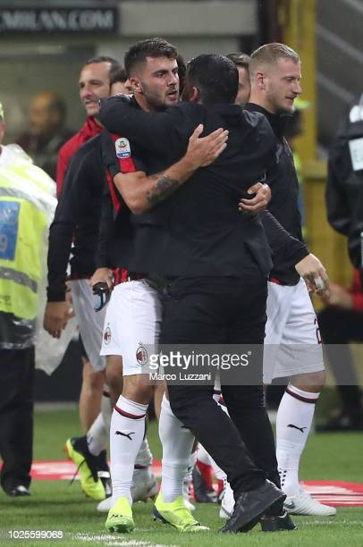 Patrick Cutrone of AC Milan celebrates his goal with his coach Gennaro Gattuso during the serie A match between AC Milan and AS Roma at Stadio...