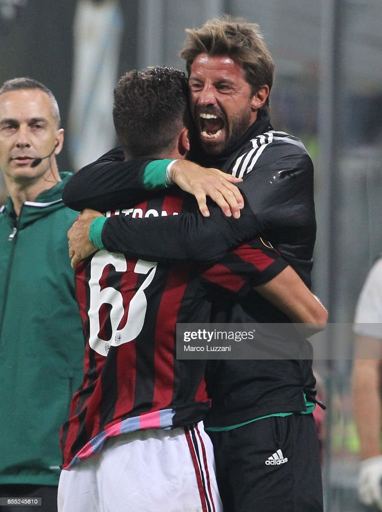 Patrick Cutrone of AC Milan celebrates his goal with his team-mate Marco Storari during the UEFA Europa League group D match between AC Milan and HNK Rijeka at Stadio Giuseppe Meazza on September 28, 2017 in Milan, Italy.