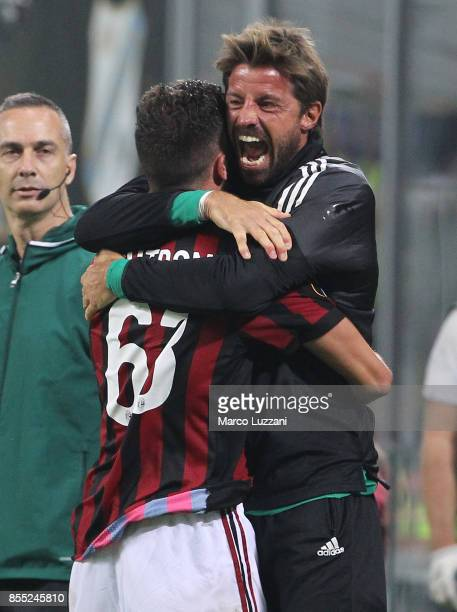 Patrick Cutrone of AC Milan celebrates his goal with his teammate Marco Storari during the UEFA Europa League group D match between AC Milan and HNK...