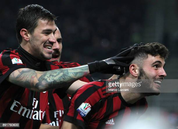 Patrick Cutrone of AC Milan celebrates his goal with his teammate Alessio Romagnoli during the Tim Cup match between AC Milan and Hellas Verona FC at...