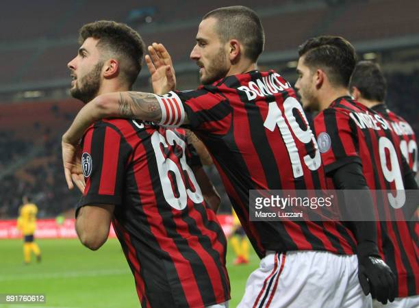 Patrick Cutrone of AC Milan celebrates his goal with his teammate Leonardo Bonucci during the Tim Cup match between AC Milan and Hellas Verona FC at...