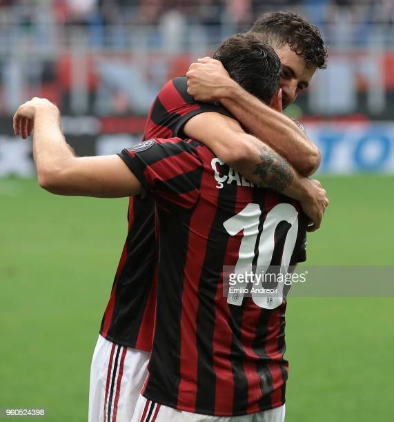 Patrick Cutrone of AC Milan celebrates his goal with his teammate Hakan Calhanoglu during the serie A match between AC Milan and ACF Fiorentina at...