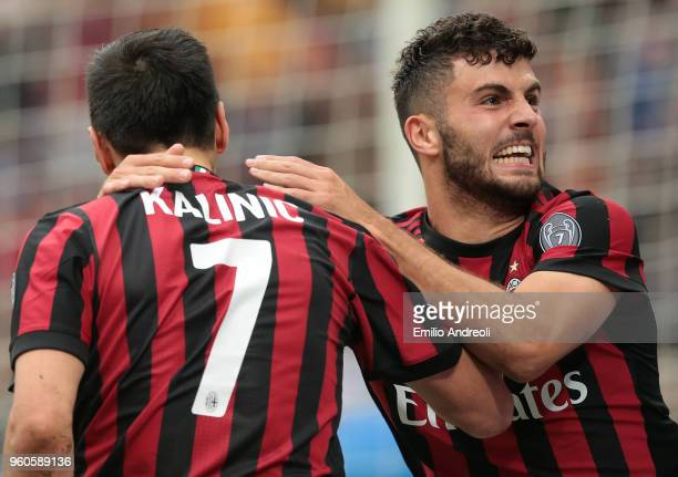 Patrick Cutrone of AC Milan celebrates his goal with his teammate Nikola Kalinic during the serie A match between AC Milan and ACF Fiorentina at...