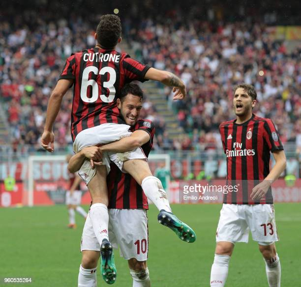 Patrick Cutrone of AC Milan celebrates his second goal with his teammate Hakan Calhanoglu during the Serie A match between AC Milan and ACF...