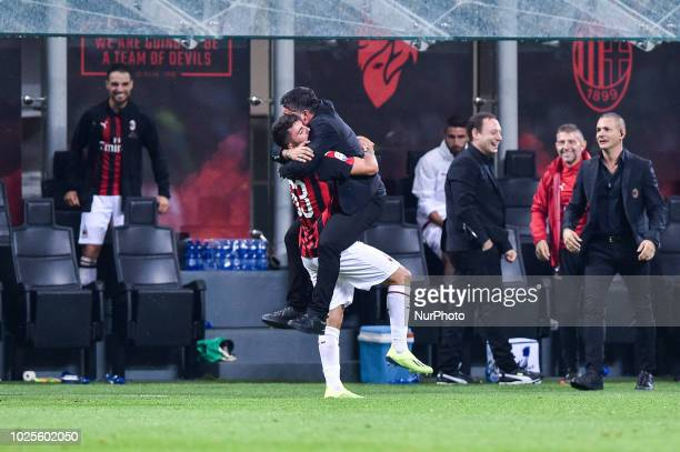 Patrick Cutrone of AC Milan celebrates with Gennaro Gattuso manager of AC Milan scoring second goal during Serie A match between AC Milan v AS Roma...