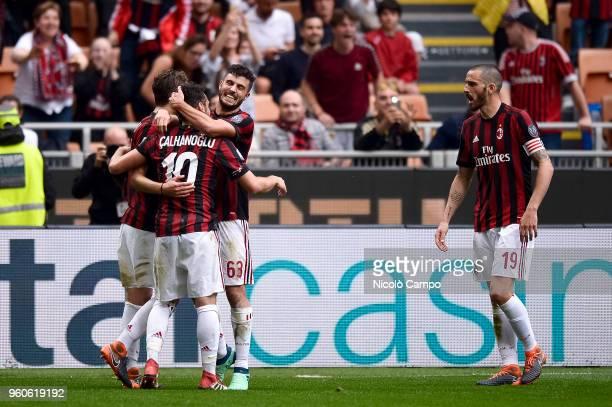 Patrick Cutrone of AC Milan celebrates with Hakan Calhanoglu after scoring a goal during the Serie A football match between AC Milan and ACF...