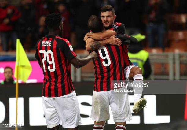 Patrick Cutrone of AC Milan celebrates with his teammates Gonzalo Higuain and Franck Kessie after scoring the opening goal during the Serie A match...
