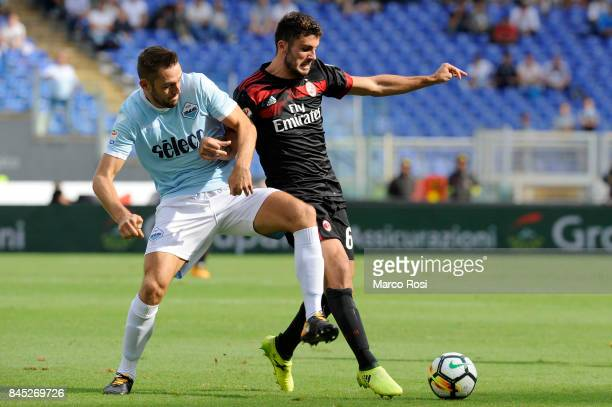 Patrick Cutrone of AC Milan compete for the ball with Stefan De Vrij of SS Lazio during the Serie A match between SS Lazio and AC Milan at Stadio...
