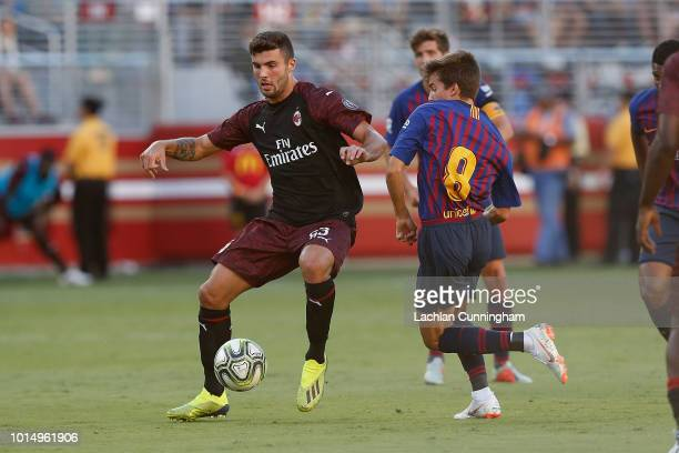 Patrick Cutrone of AC Milan competes for the ball against Ricky Puig of FC Barcelona during the International Champions Cup match at Levi's Stadium...