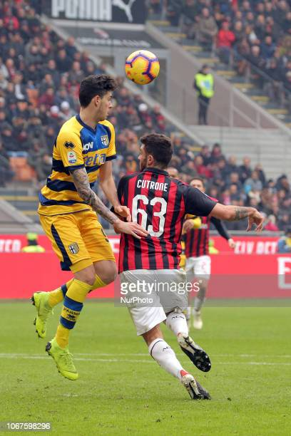 Patrick Cutrone of AC Milan competes for the ball with Alessandro Bastoni of Parma Calcio 1913 during the serie A match between AC Milan and Parma...