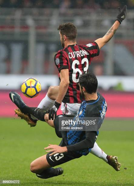 Patrick Cutrone of AC Milan competes for the ball with Andrea Ranocchia of FC Internazionale Milano during the TIM Cup match between AC Milan and FC...