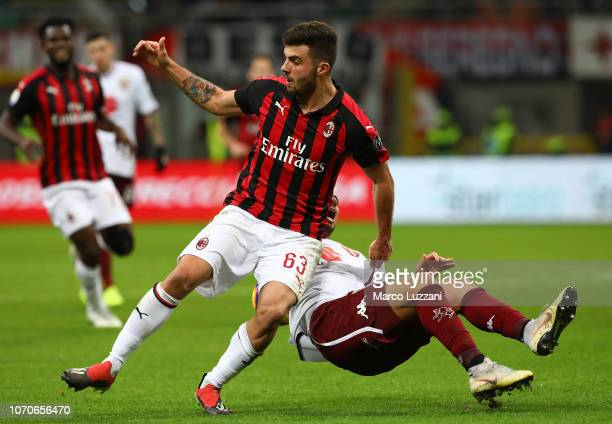Patrick Cutrone of AC Milan competes for the ball with Armando Izzo of Torino FC during the Serie A match between AC Milan and Torino FC at Stadio...