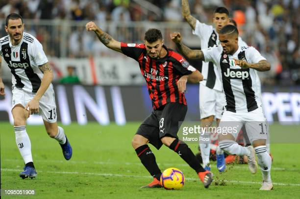 Patrick Cutrone of AC Milan competes for the ball with Douglas Costa of Juventus during the Italian Supercup match between Juventus and AC Milan at...