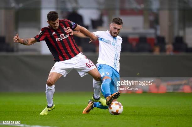 Patrick Cutrone of AC Milan competes for the ball with Josip Elez of HNK Rijeka during the UEFA Europa League Group D match between AC Milan and HNK...