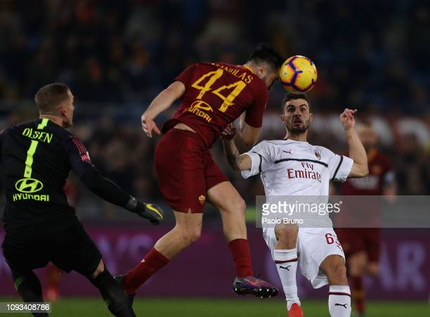 Patrick Cutrone of AC Milan competes for the ball with Kostas Manolas of AS Roma during the Serie A match between AS Roma and AC Milan at Stadio...