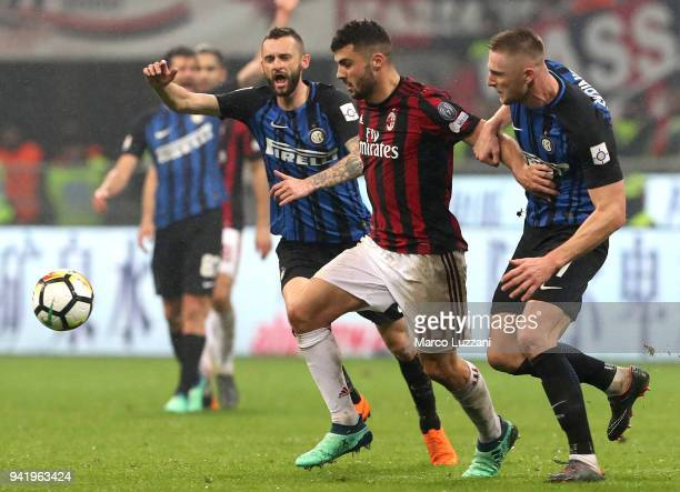 Patrick Cutrone of AC Milan competes for the ball with Milan Skriniar of FC Internazionale during the Serie A match between AC Milan and FC...