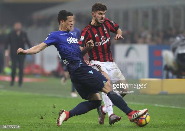 Patrick Cutrone of AC Milan competes for the ball with Ramos Luiz Felipe of SS Lazio during the TIM Cup match between AC Milan and SS Lazio at Stadio...