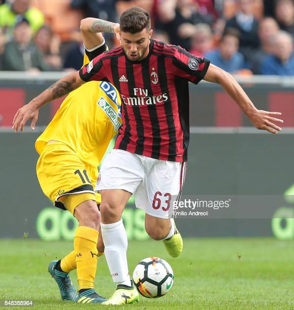 Patrick Cutrone of AC Milan competes for the ball with Rodrigo De Paul of Udinese Calcio during the Serie A match between AC Milan and Udinese Calcio...