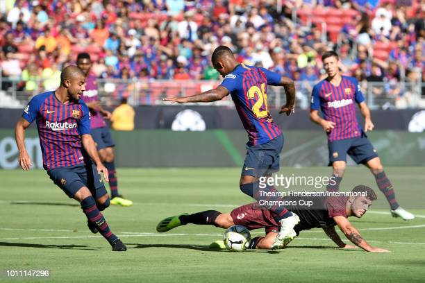Patrick Cutrone of AC Milan falls after a challenge by Rafinha of FC Barcelona during their International Champions Cup match at Levi's Stadium on...
