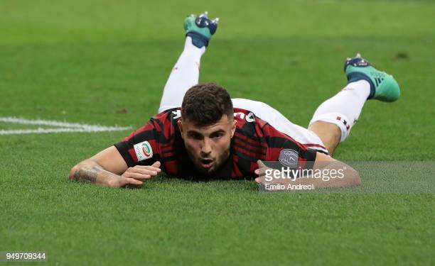 Patrick Cutrone of AC Milan reacts after misses a chance of goal during the serie A match between AC Milan and Benevento Calcio at Stadio Giuseppe...