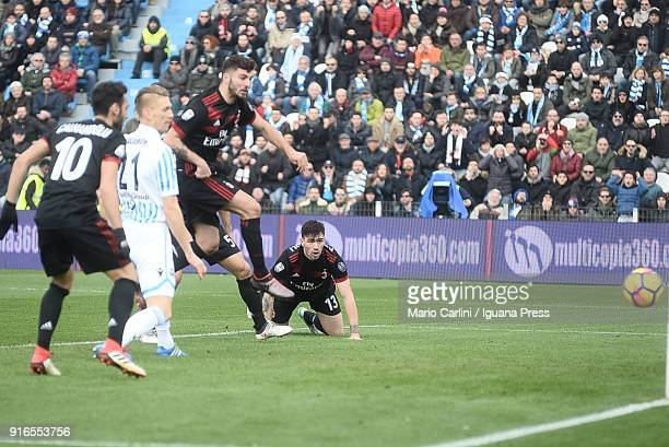Patrick Cutrone of AC Milan scores the opening goal during the serie A match between Spal and AC Milan at Stadio Paolo Mazza on February 10 2018 in...