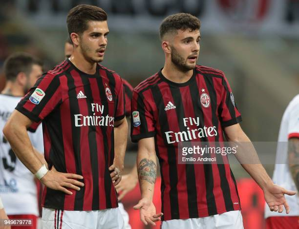 Patrick Cutrone of AC Milan speaks with his teammate Andre Silva during the serie A match between AC Milan and Benevento Calcio at Stadio Giuseppe...