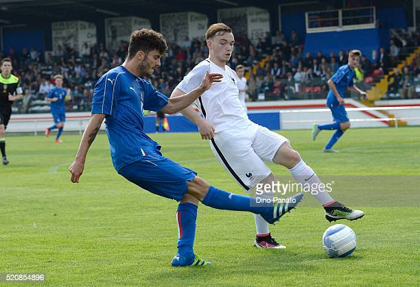 Patrick Cutrone of Italy competes with Bradlay Danger of France during the U18 international friendly match between Italy and France at Stadio...