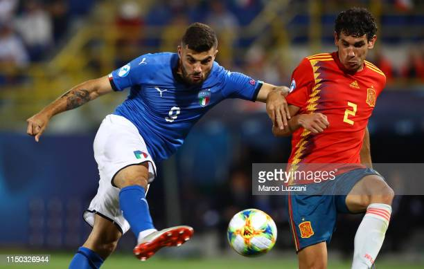 Patrick Cutrone of Italy is challenged by Jesus Vallejo of Spain during the 2019 UEFA U21 Group A match between Italy and Spain at on June 16 2019 in...
