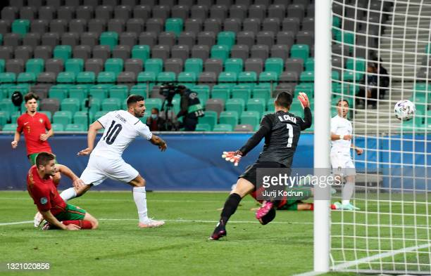 Patrick Cutrone of Italy scores their side's third goal past Diogo Costa of Portugal during the 2021 UEFA European Under-21 Championship...