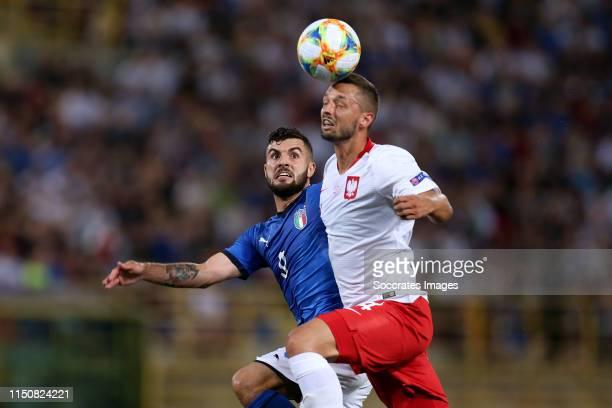 Patrick Cutrone of Italy U21 Mateusz Wieteska of Poland U21 during the EURO U21 match between Italy v Poland at the Stadio Renato Dall'Ara on June 19...