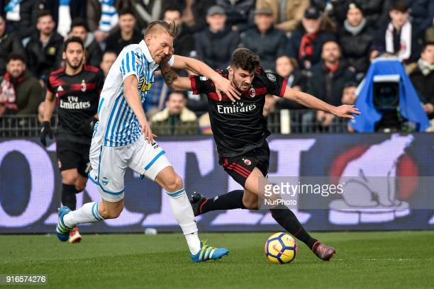 Patrick Cutrone of Milan is challenged by Bartosz Salamon of SPAL during the Serie A match between SPAL and AC Milan at Paolo Mazza Stadium Ferrara...