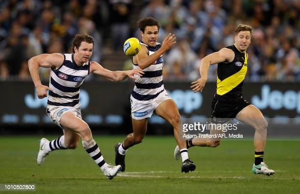 Patrick Dangerfield and Jamaine Jones of the Cats compete for the ball with Kane Lambert of the Tigers during the 2018 AFL round 20 match between the...