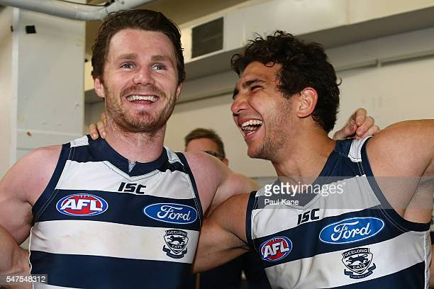 Patrick Dangerfield and Nakia Cockatoo of the Cats sing the club song after winning the round 17 AFL match between the Fremantle Dockers and the...