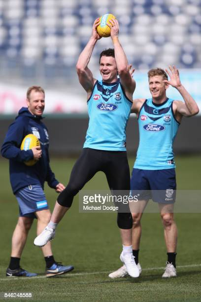 Patrick Dangerfield marks the ball ahead of Scott Selwood during the Geelong Cats AFL training session at Simonds Stadium on September 13 2017 in...