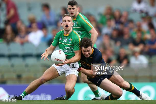 Patrick Dangerfield of Australia tackles Niall Sludden of Ireland during game two of the International Rules Series between Australia and Ireland at...