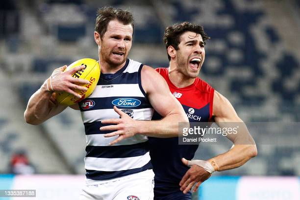 Patrick Dangerfield of the Cats and Christian Petracca of the Demons in action during the round 23 AFL match between Geelong Cats and Melbourne...