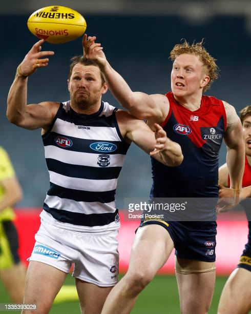 Patrick Dangerfield of the Cats and Clayton Oliver of the Demons contest the ball during the round 23 AFL match between Geelong Cats and Melbourne...