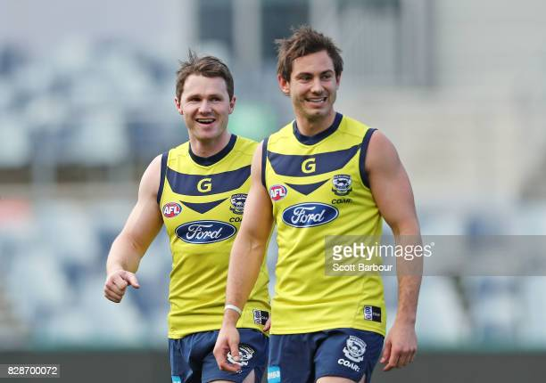 Patrick Dangerfield of the Cats and Daniel Menzel of the Cats look on during a Geelong Cats AFL training session at Simonds Stadium on August 10 2017...