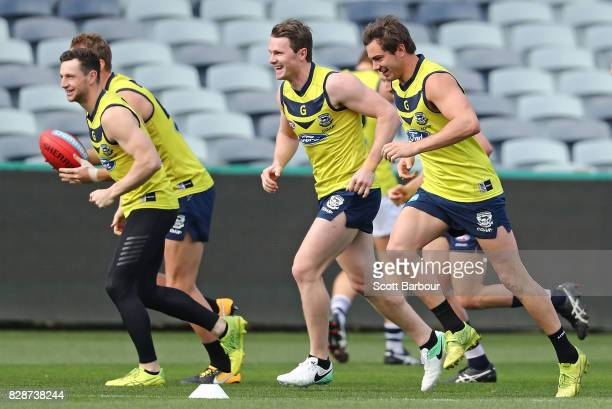 Patrick Dangerfield of the Cats and Daniel Menzel of the Cats run during a Geelong Cats AFL training session at Simonds Stadium on August 10 2017 in...